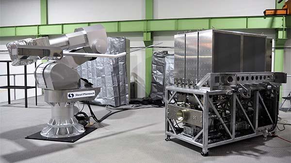 ロボット本体(左)とプローブ交換機(右)